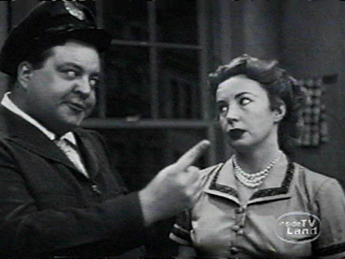 Ralph Kramden in The Honeymooners, hilariously threatening to beat his wife.