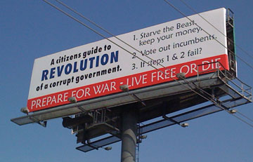 A billboard sponsored by the in Lafayette County, Missouri, Republican Party, suggesting that citizens prepare themselves for war against the United States government.