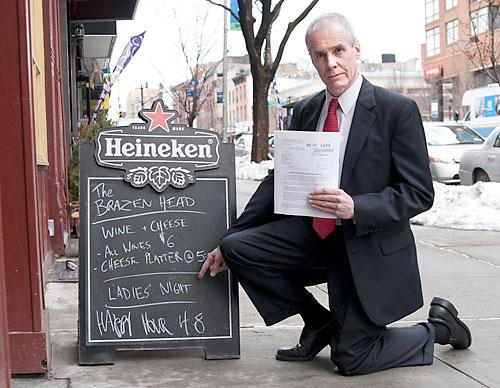 Self-described antifeminist attorney Roy Den Hollander, with subpoena and unfair cheese