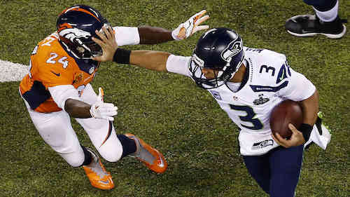 The Seahawks ram it through the Broncos' tight little defense.