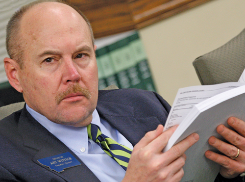 Montana Senate Majority Leader Art Wittich (R-Bozeman) reads a non-Bible book.