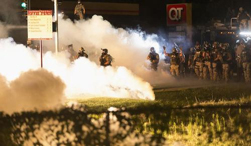 Police in Ferguson, Missouri disperse a protest using gas bombs.