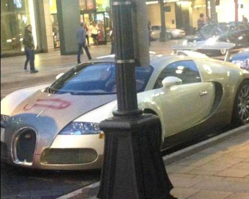 A $2.5 million Bugatti with a penis painted on it. Kombat! Kids: Can you find the komposition mistake in this photo?