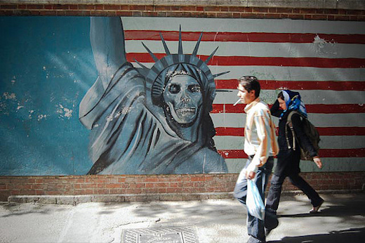 A mural decrying the Great Satan on the former US embassy in Tehran. Photo by John Kavanaugh