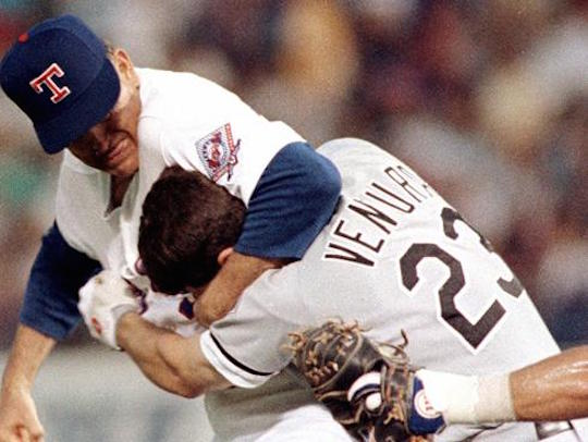 Nolan Ryan punches Robin Ventura in the head during a 1993 baseball game.