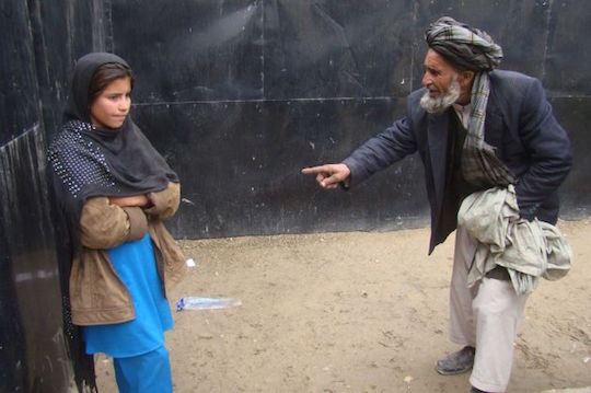 A father addresses his daughter at a women's shelter in Afghanistan.
