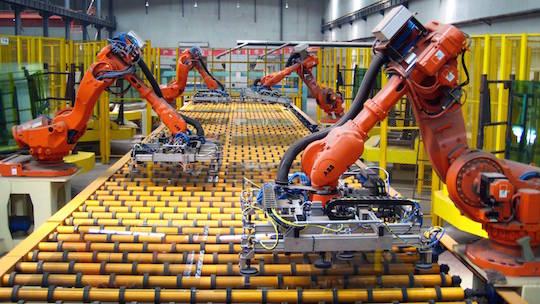 Robots print funny cultural criticism on screens at the Combat! factory.