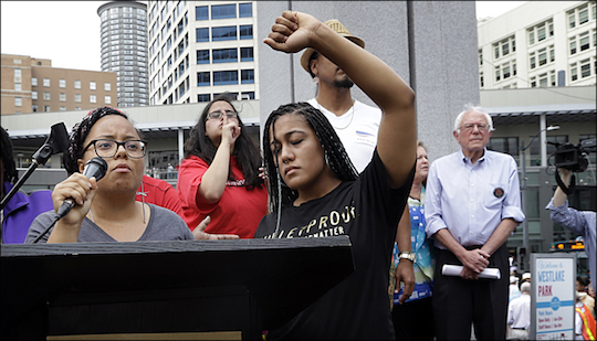 Protestors Marissa Johnson and Mara Jacqueline Willaford take the podium at a Sanders rally Saturday.