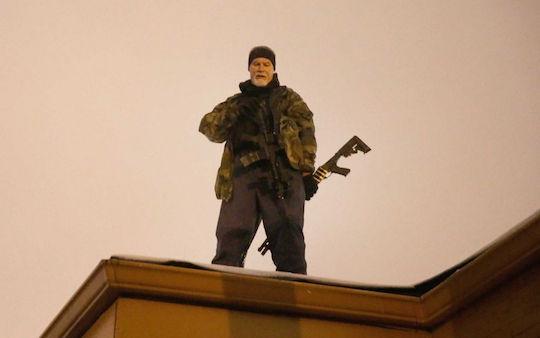 Oath Keeper John Karriman stands on a Ferguson rooftop in 2014.