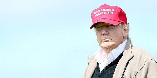 Trump and a hat that suggests America sucks