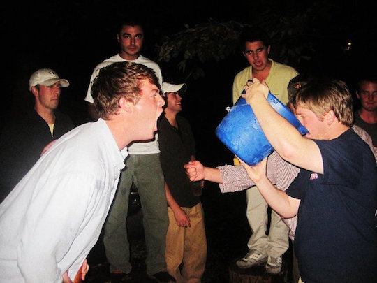 The brothers of Delta Fresca Nu drink a bucket of rum to help the poor.