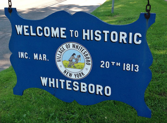 A sing on the village green welcomes statistically non-Indian visitors to Whitesboro (AP).
