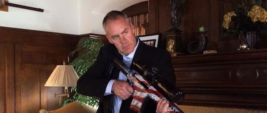Rep. Ryan Zinke prepares to crack a walnut.