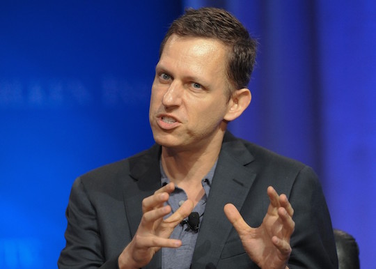Peter Thiel makes a grasping, strangling gesture.
