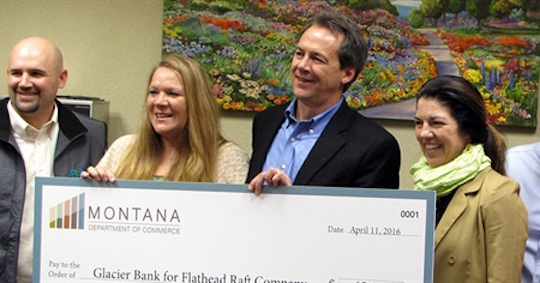 What's going on between Governor Bullock and this big check?