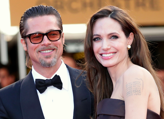 Brad Pitt and Angelina Jolie, trained actors, smile.