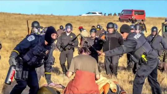 Police arrest a protestor at the Dakota Access Pipeline in North Dakota.